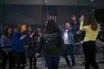 Campaign staff cheer after Democratic Presidential candidate former Vice President Joe Biden addressed media during a primary night event on March 10, 2020 in Philadelphia, Pennsylvania