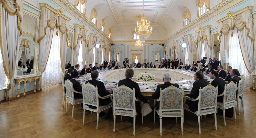 Russian President Vladimir Putin, 3rd from left, meets with members of the International Expert Council of the Russian Direct Investment Fund (RDIF) and representatives of the world investment community at a working lunch on the second day of the St. Petersburg International Economic Forum (SPIEF) in the Konstantinov Palace in St. Petersburg