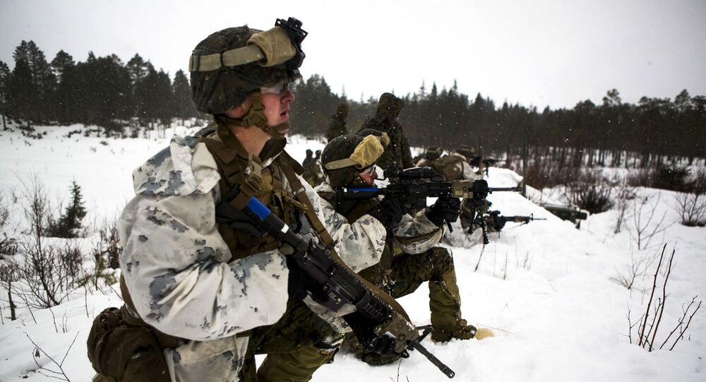 Marines participate in a platoon assault drill as a part of Exercise Cold Response 16 on range U-3 in Frigard, Norway, Feb. 23, 2016