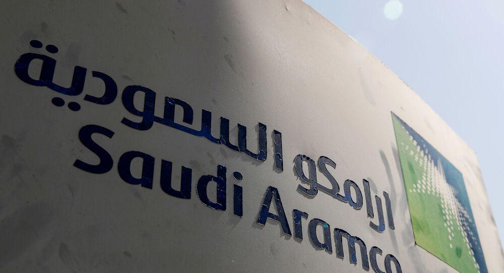 FILE PHOTO: Saudi Aramco logo is pictured at the oil facility in Khurais, Saudi Arabia October 12, 2019.