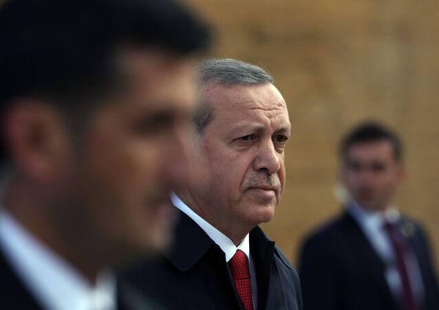 Turkish President Recep Tayyip Erdogan is surrounded by his bodyguards as he walks to the mausoleum of Turkey's founder Mustafa Kemal Ataturk on Republic Day in Ankara, Turkey. File photo.