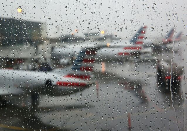 Airplanes are seen parked through a rain soaked window at their gates during a winter nor'easter at LaGuardia Airport in New York