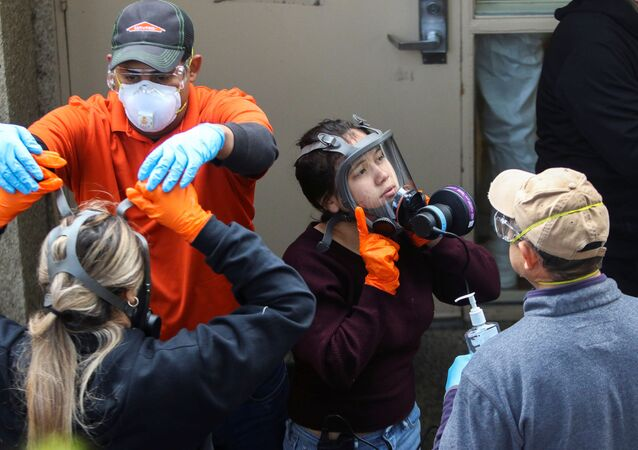 Members of a Servpro cleaning crew take off their protective gears as they exit the Life Care Center of Kirkland, the Seattle-area nursing home at the epicenter of one of the biggest coronavirus outbreaks in the United States, in Kirkland, Washington, U.S. March 11, 2020.