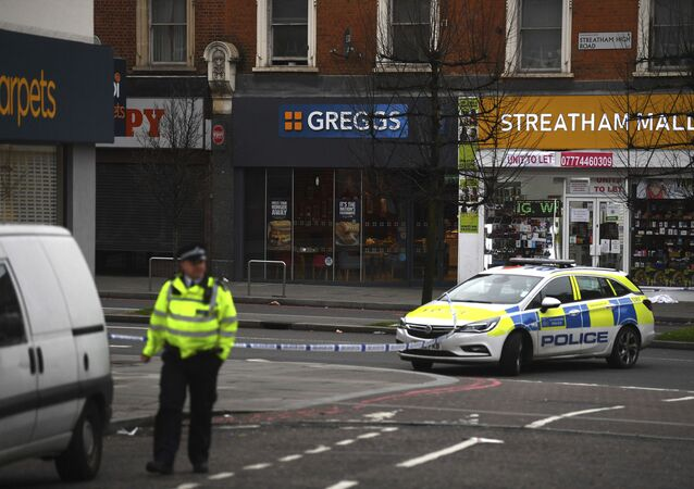 Police attend the scene after an incident in Streatham, London