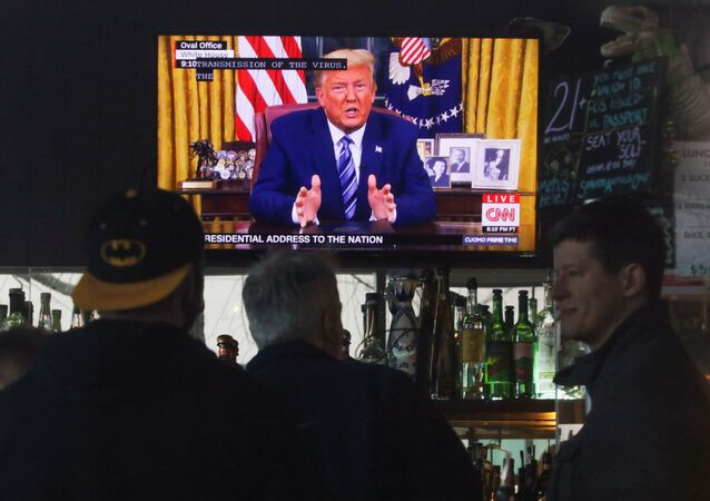 U.S. President Donald Trump's televised address to the nation is pictured in the bar at A Pizza Mart, in Seattle, Washington, U.S. March 11, 2020.