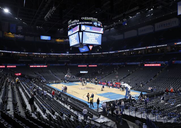 Fans leave after an announcement that the Oklahoma City Thunder vs. Utah Jazz game is canceled