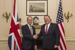 UK Foreign Secretary Dominic Raab shakes hands with US Secretary of State Mike Pompeo, right, in London, Wednesday Jan. 29, 2020.