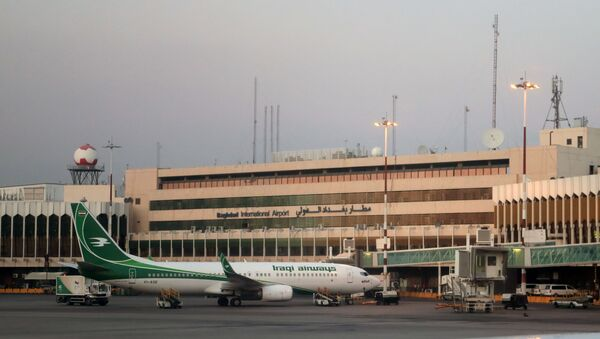 Iraqi airways aircraft is parked next to the building of the International airport of Baghdad, Iraq. - Sputnik International