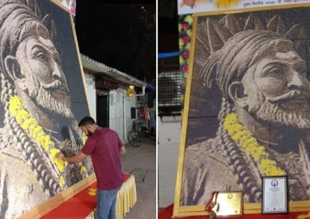 Nitin Dinesh Kamble created the 10×8 feet mosaic portrait of Chhatrapati Shivaji Maharaj in 10 days using 46,080 plastic bits of six different colours