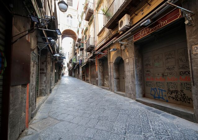 A view of an empty street on the second day of an unprecedented lockdown across all of the country, imposed to slow the outbreak of coronavirus, in Naples, Italy March 11, 2020