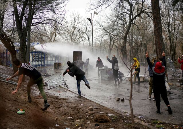 Greek riot police use a water cannon to disperse stone throwing migrants as they wait on the no man's land between Turkey and Greece, at Turkey's Pazarkule border crossing with Greece's Kastanies, in Edirne, Turkey, March 8, 2020.