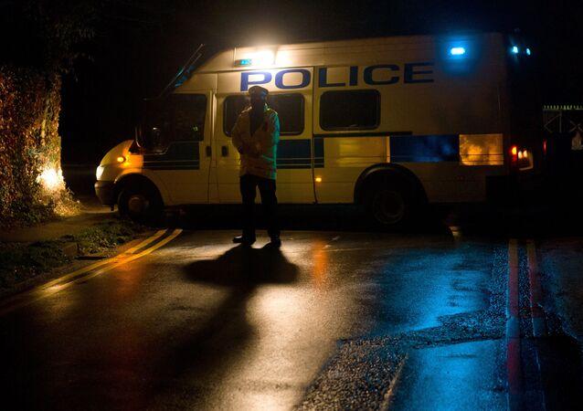 A police van blocks a road in Sunningdale, Berkshire, southwest of London (File)