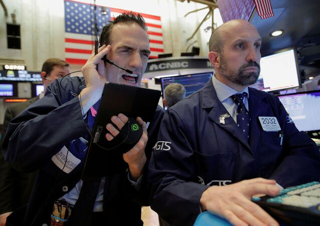 Traders work on the floor of the New York Stock Exchange (NYSE) in New York, U.S., March 12, 2020