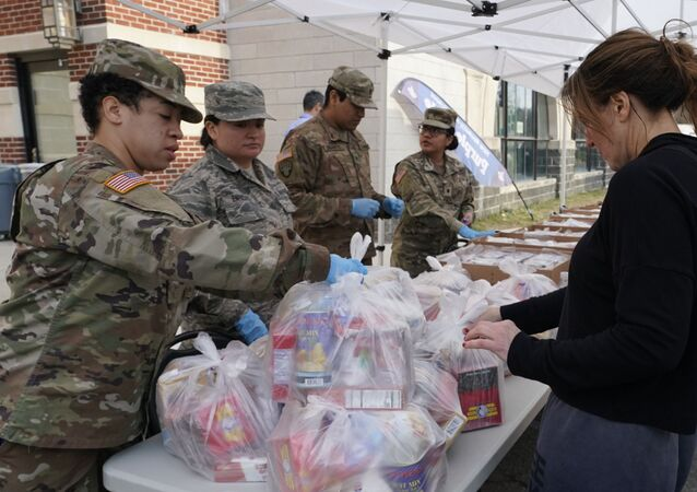 National Guard troops give food to residents of New Rochelle, New York at New Rochelle High School March 12, 2020