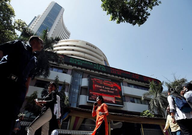 People walk past the Bombay Stock Exchange (BSE) building in Mumbai, India, March 9, 2020