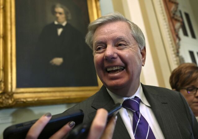 Sen. Lindsey Graham, R-S.C., talks to reporters on Capitol Hill in Washington, Tuesday, Feb. 25, 2020.