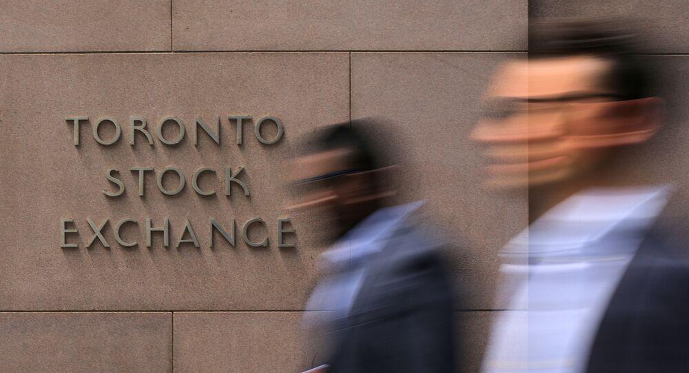 Businessmen pass the Toronto Stock Exchange sing in Toronto, Ontario, Canada July 6, 2017.