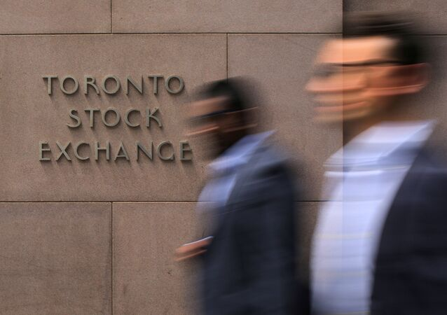 Businessmen pass the Toronto Stock Exchange sing in Toronto, Ontario, Canada July 6, 2017.