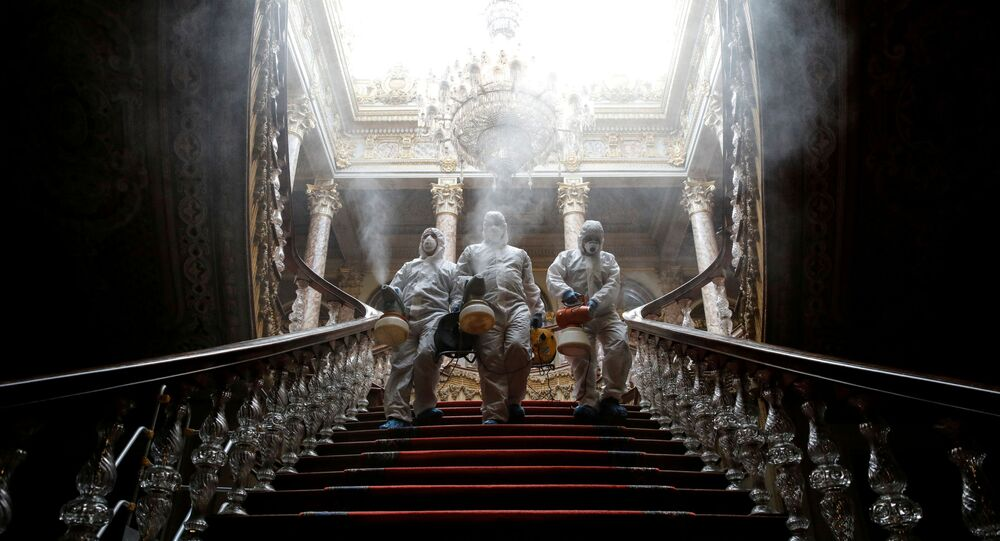 Workers in protective suits disinfect Dolmabahce Palace due to coronavirus concerns in Istanbul