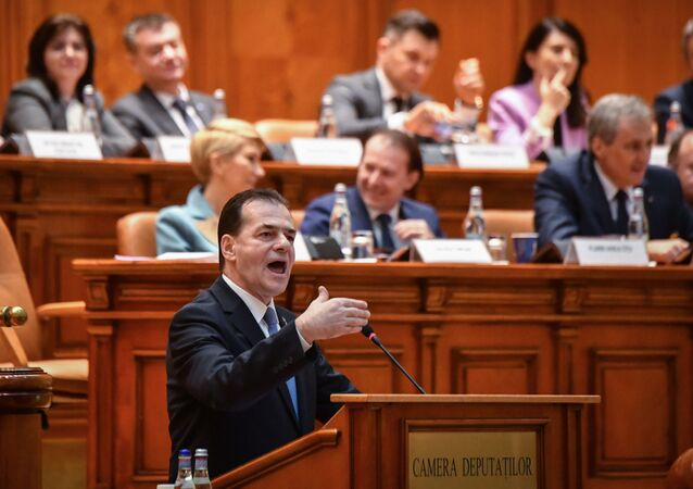 Romanian Prime Minister Ludovic Orban delivers his speech during a no-confidence vote initiated by the Social Democrat Party (PSD) at the Romanian Parliament in Bucharest on February 5, 2020