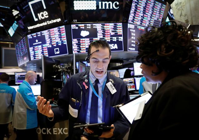 Traders work on the floor of the New York Stock Exchange (NYSE) near the close of trading in New York, U.S., March 12, 2020