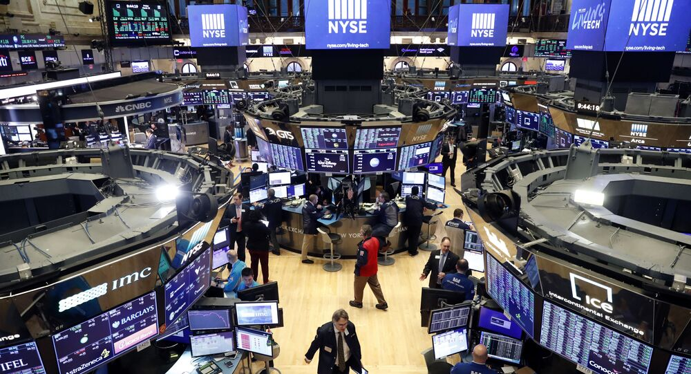 Traders work on the floor of the New York Stock Exchange (NYSE) after the opening bell of the trading session in New York, U.S., March 13, 2020