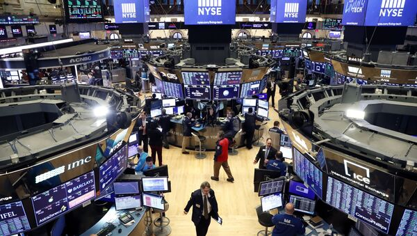 Traders work on the floor of the New York Stock Exchange (NYSE) after the opening bell of the trading session in New York, U.S., March 13, 2020 - Sputnik International
