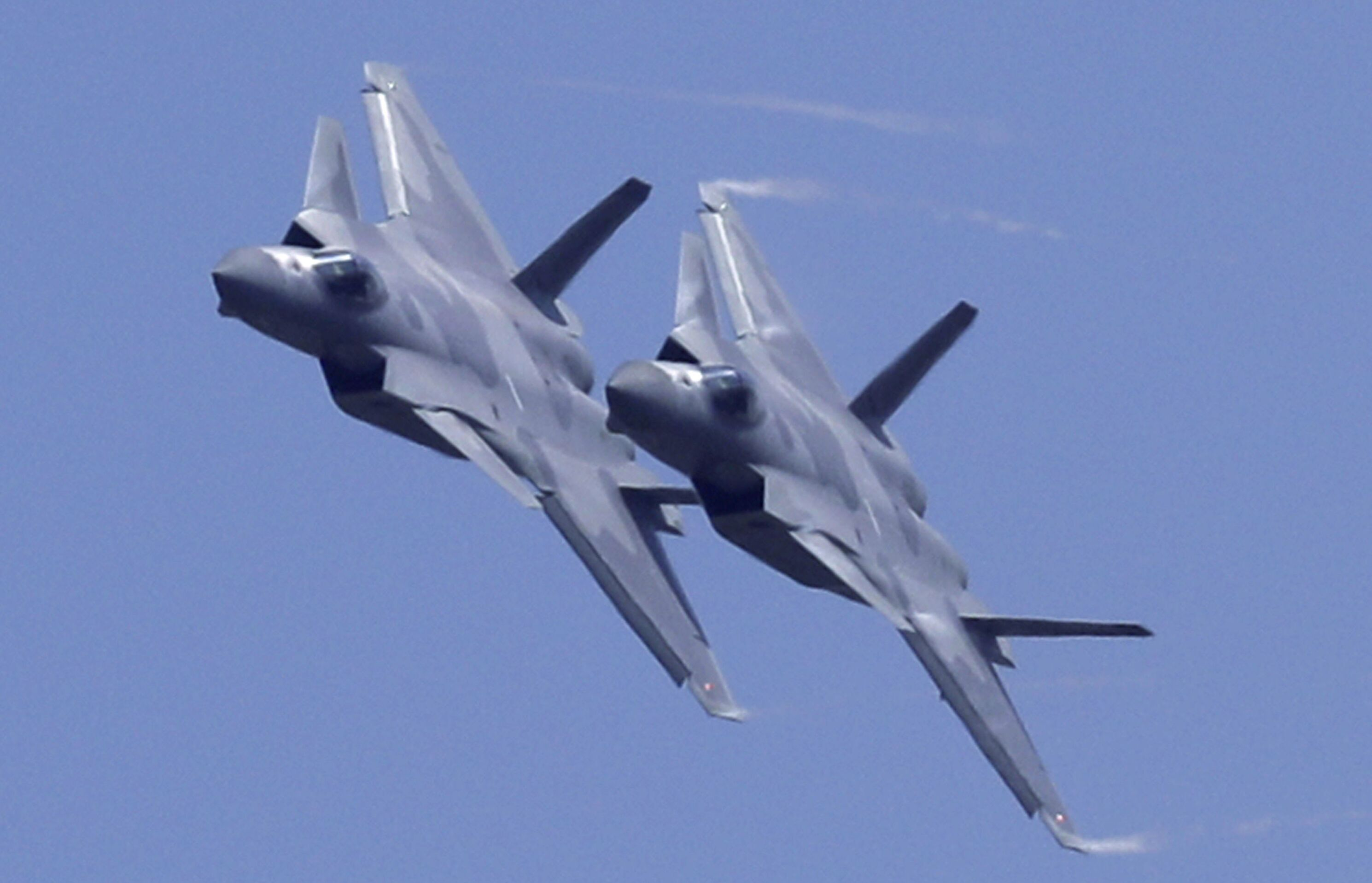 Two J-20 stealth fighter jets of the Chinese People's Liberation Army (PLA) Air Force performs during the 12th China International Aviation and Aerospace Exhibition, also known as Airshow China 2018, Tuesday, Nov. 6, 2018, in Zhuhai city, south China's Guangdong province