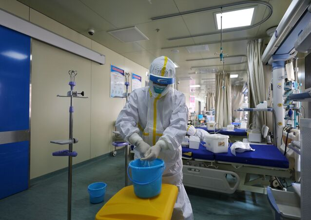 Medical workers in protective suits disinfect an intensive care unit (ICU) ward of Union Jiangbei Hospital in Wuhan, the epicentre of the novel coronavirus outbreak, Hubei province, China March 12, 2020. Picture taken March 12, 2020