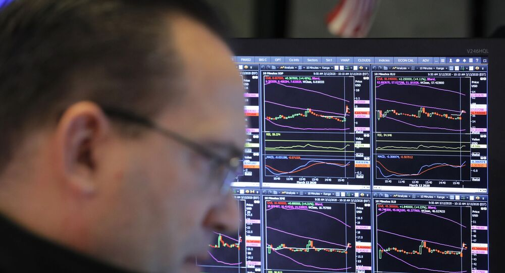 A trader works on the floor of the New York Stock Exchange (NYSE) after the opening bell of the trading session in New York, U.S., March 13, 2020
