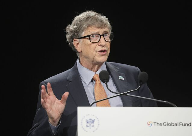 Bill Gates gestures as he speaks to the audience during the Global Fund to Fight AIDS event