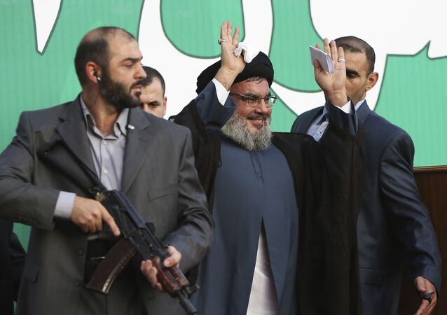 In this Sept 17, 2012 file photo, Hezbollah leader Sheik Hassan Nasrallah, center, escorted by his bodyguards, waves to a crowd of tens of thousands of supporters during a rally denouncing an anti-Islam film that has provoked a week of unrest in Muslim countries worldwide, in a southern suburb of Beirut, Lebanon.