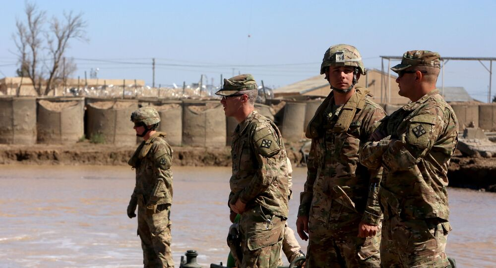 US army forces supervise during a training session at the Taji camp, north of Baghdad, with Iraqi soldiers, aimed at preparing them to install floating bridges, ahead of installing replacement ones in Mosul, on March 6, 2017