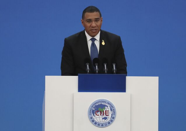 Jamaica's Prime Minister Andrew Holness delivers a speech at the opening ceremony of the China International Import Expo in Shanghai on Tuesday, Nov. 5, 2019. The sprawling import fair into its second year is meant to demonstrate China's willingness to open its domestic markets.