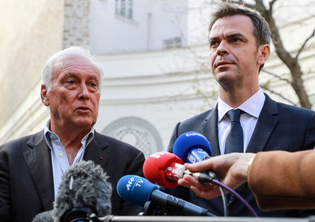 French Health and Solidarity Minister Olivier Veran and immunologist Jean-Francois Delfraissy address the media in the courtyard of the French Interior Ministry in Paris, France March 13, 2020.