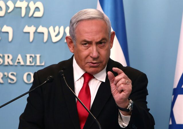 Israeli Prime Minister Benjamin Netanyahu gestures as he delivers a speech at his Jerusalem office, regarding the new measures that will be taken to fight the coronavirus, March 14, 2020.