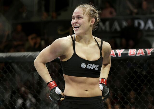 Ronda Rousey looks around after defeating Sara McMann in a UFC 170
