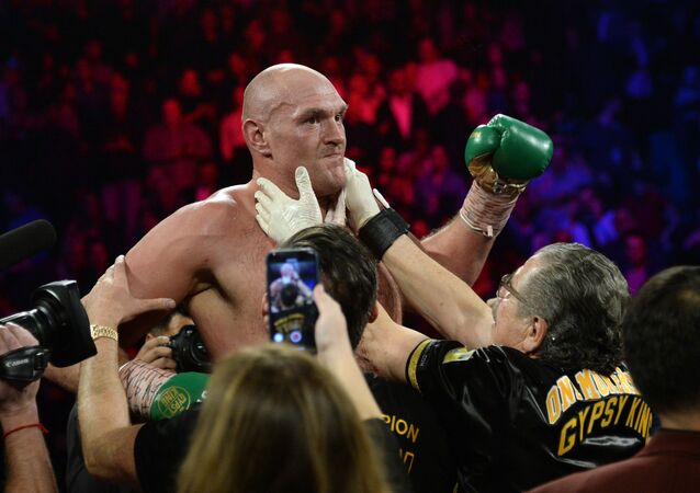 Tyson Fury celebrates after defeating Deontay Wilder in their WBC heavyweight title bout