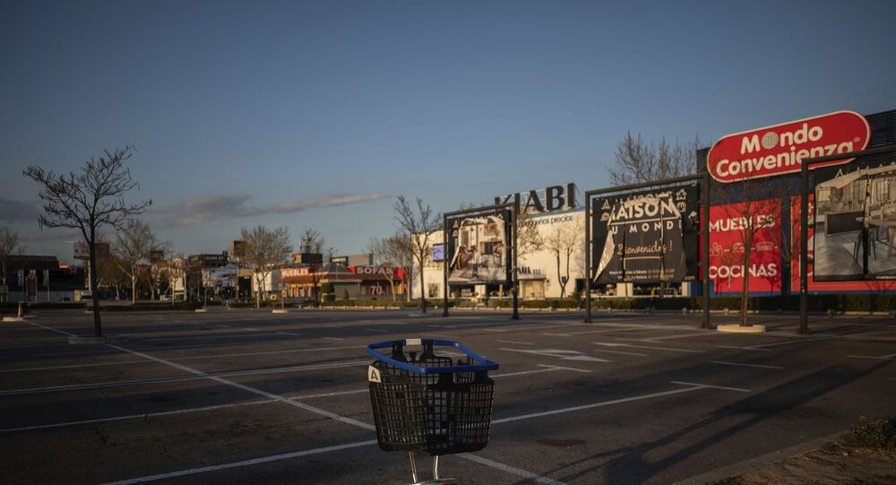A shopping cart in the middle of an empty parking lot in a shopping area in San Sebastian de los Reyes, outskirts Madrid, Spain, Saturday, March 14, 2020. Spain's government announced Saturday that it is placing tight restrictions on movements and closing restaurants and other establishments in the nation of 46 million people as part of a two-week state of emergency to fight the sharp rise in coronavirus infections. Spain has followed Italy's path in implementing a similar lockdown after both European countries failed to contain the virus in regional hotspots. The vast majority of people recover from the new coronavirus. According to the World  Health Organization, most people recover in about two to six weeks, depending on the severity of the illness.