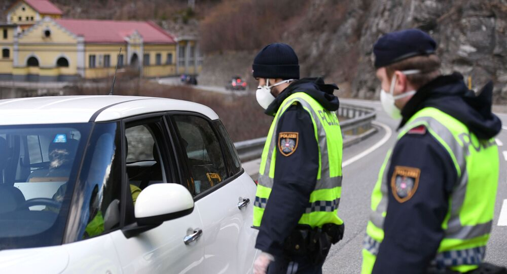 Austrian police officers inform drivers about the quarantine of Paznaun valley