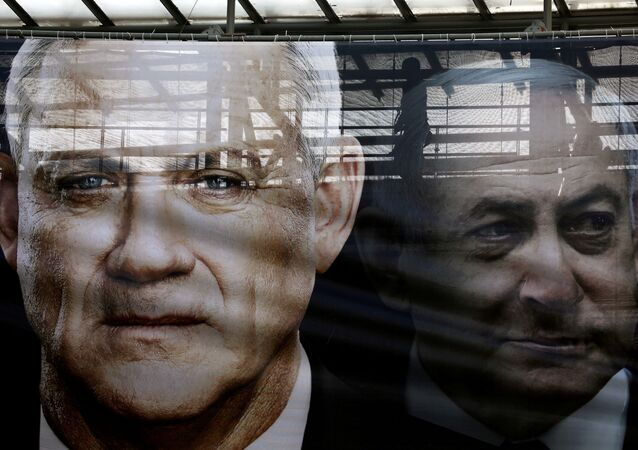 A banner depicts Benny Gantz, leader of Blue and White party, and Israel Prime minister Benjamin Netanyahu