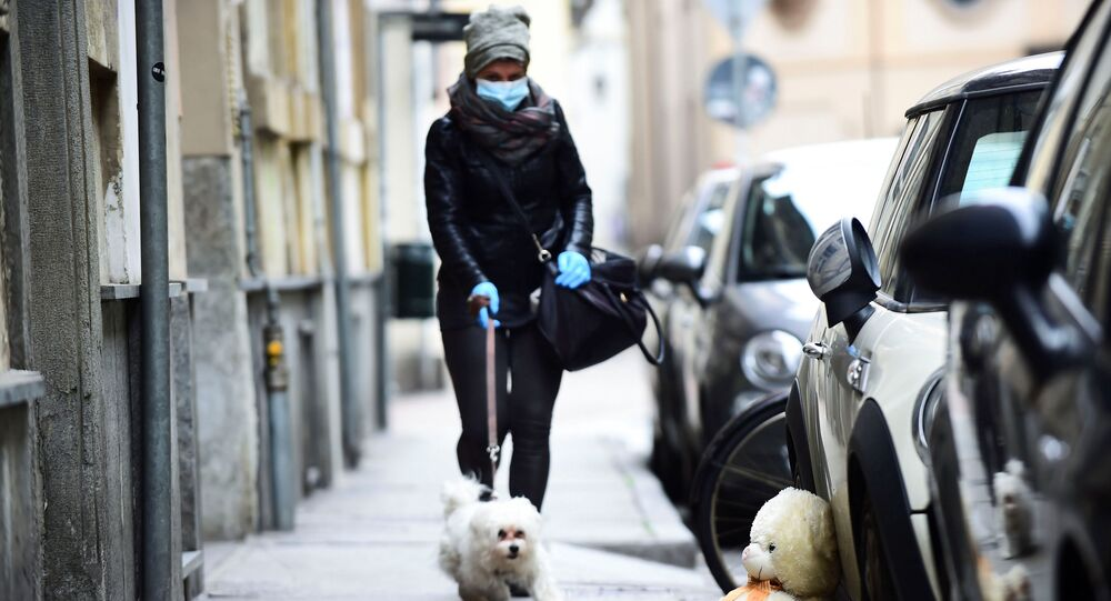 A woman wearing a face mask in Turin, Italy