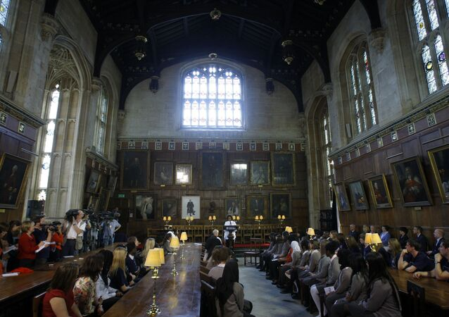 U.S. first lady Michelle Obama, centre rear,  speaks to children from Elizabeth Garrett Anderson school in London as they visit Christ Church College in Oxford, England, Wednesday, May 25, 2011.