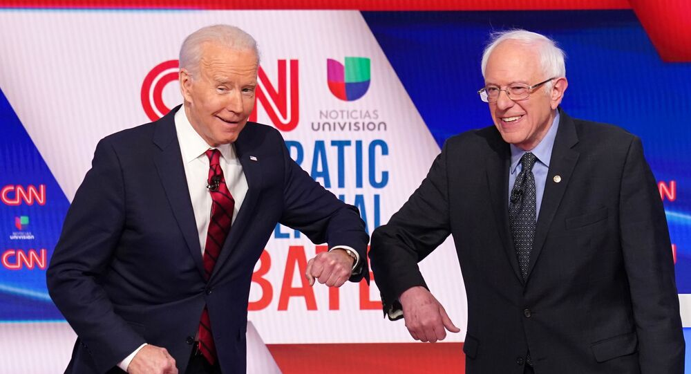 Democratic U.S. presidential candidates former Vice President Joe Biden and Senator Bernie Sanders do an elbow bump in place of a handshake as they greet other before the start of the 11th Democratic candidates debate of the 2020 U.S. presidential campaign, held in CNN's Washington studios without an audience because of the global coronavirus pandemic, in Washington, U.S. March 15, 2020.