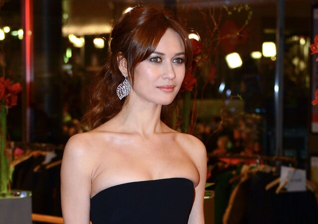 French actress and model of Ukrainian descent Olga Kurylenko on the red carpet at the closing ceremony of the 65th Berlin International Film Festival Berlinale 2015.
