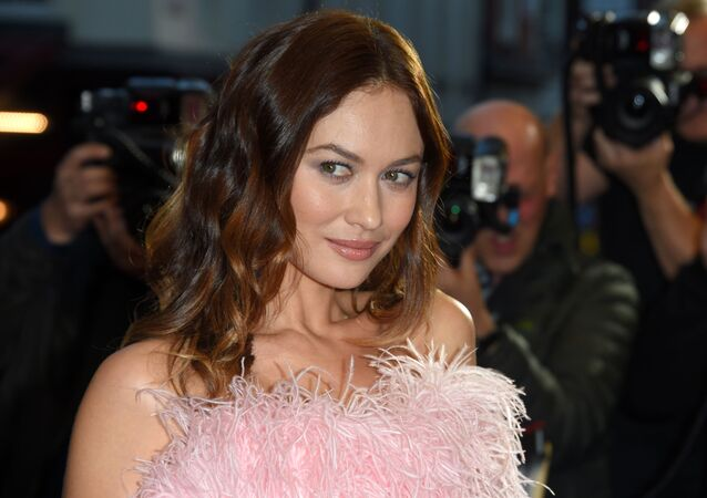 Actress Olga Kurylenko poses on the red carpet upon arrival for a special screening of the film Johnny English Strikes Again in central London on October 3, 2018.