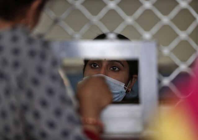Indians wear masks inside Government Medical College hospital in Jammu, India, Monday, March 16, 2020. For most people, the new coronavirus causes only mild or moderate symptoms. For some, it can cause more severe illness, especially in older adults and people with existing health problems.