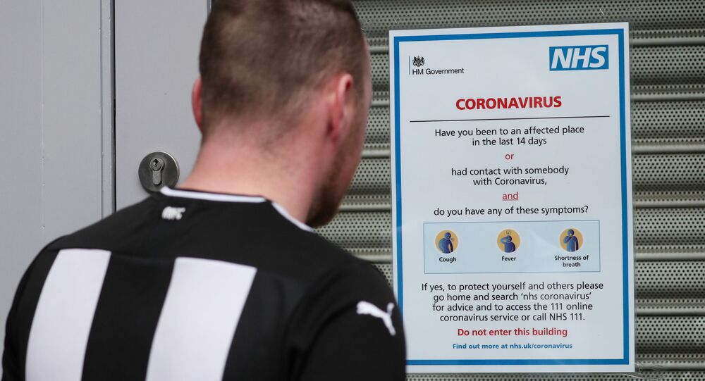 Soccer Football - Premier League - Coronavirus impact on the Premier League - St James' Park, Newcastle, Britain - March 14, 2020  A fan reads a NHS sign outside St James' Park as the Premier League is suspended due to the number of coronavirus cases growing around the world