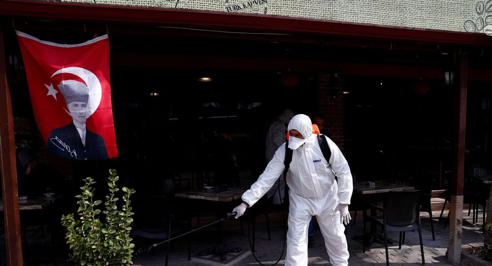 A municipality worker wearing protective suit sanitises a coffee shop in Karaagac district against the coronavirus disease (COVID-19) near Turkey's Pazarkule border crossing with Greece's Kastanies, in Edirne, Turkey, March 10, 2020
