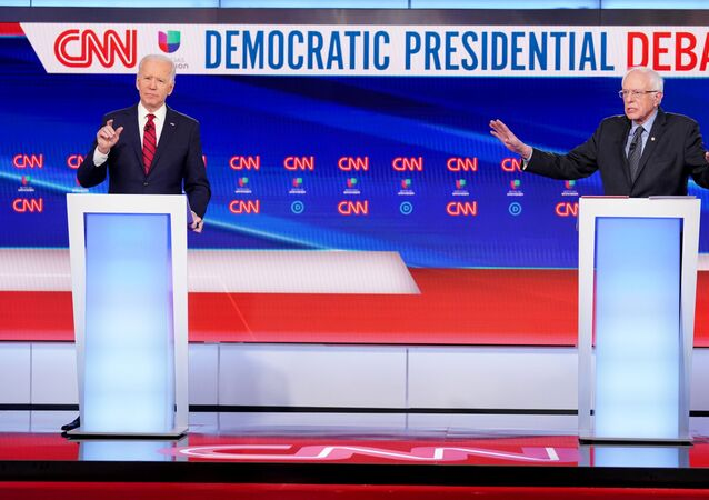 Democratic U.S. presidential candidates former Vice President Joe Biden and Senator Bernie Sanders debate during the 11th Democratic candidates debate of the 2020 U.S. presidential campaign, held in CNN's Washington studios without an audience because of the global coronavirus pandemic, in Washington, U.S., March 15, 2020
